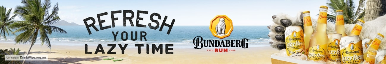 Banner image displaying a beach, the ocean and palm trees, with an esky filled with Bundaberg Rum Lazy Bear mixed drink bottles and cans to the side.